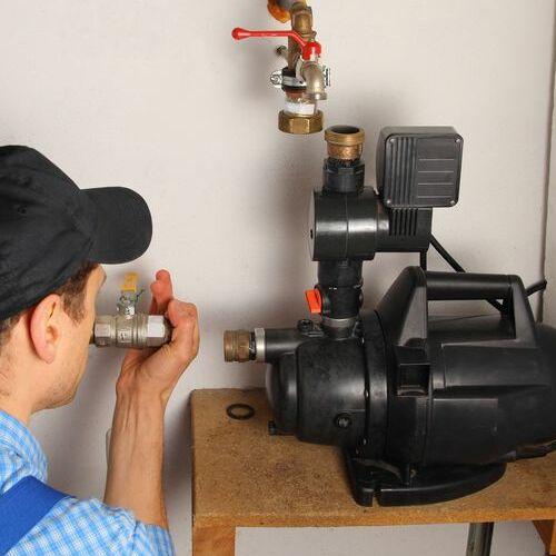 A Plumber Installs a Booster Pump.