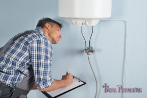 A Plumber Tests a Tankless Water Heater.